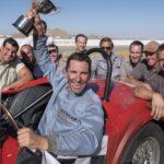 Un trionfante Christian Bale in un'immagine tratta da Le Mans '66 - La grande sfida di James Mangold (Ford v Ferrari, USA, Francia 2019)