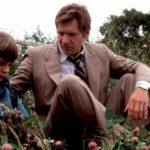 Il piccolo Lukas Haas e Harrison Ford in un pregnante momento di Witness - Il testimone di Peter Weir (USA, 1985)